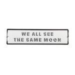 Placa we all see the same moon
